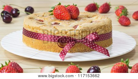 Strawberry Butter Cake On The Plate With Strawberry On Wood Background