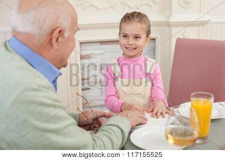 Pretty old man has a lunch with child