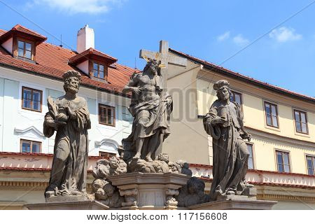 Statue Of The Holy Savior With Cosmas And Damian At Charles Bridge, Prague