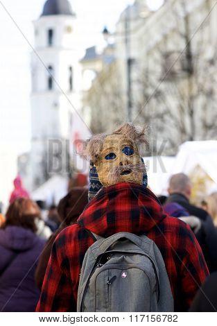 Unknown man walking in traditional lithuanian carnival mask in market in Vilnius on Feb 7