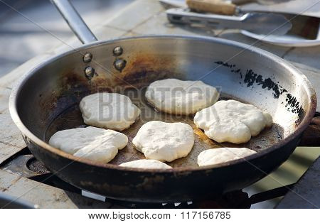 Pancake cooking in street in traditional lithuanian carnival in February
