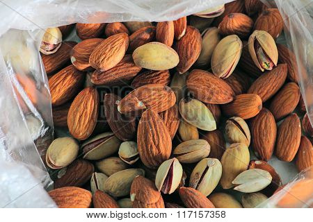 Background texture of assorted mixed nuts including almonds and pistachio