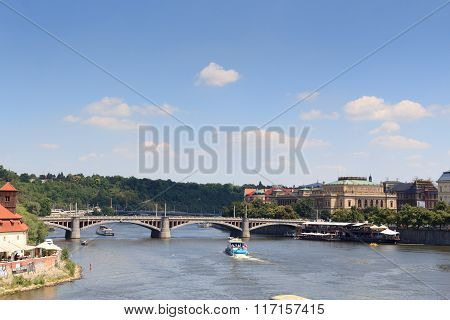 Manes Bridge, Boats On River Vltava And Czech Philharmonic In Prague