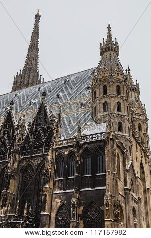 A low view of St. Stephen's Cathedral (Stephansdom) at Stephansplatz in Vienna during the winter. Snow can be seen on the building.