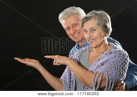 elderly couple advertising products