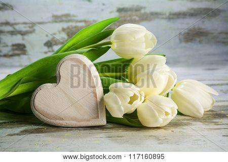 White Tulips And A Heart Of Wood On A Vintage Gray Wooden Background, Love Concept
