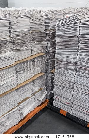 Vertical Stacks Of Newspapers On Pallets