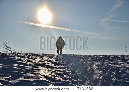 Silhouette Of Hunter. Man Walking In His Hunter Area, Hunter In Winter, Hunting,