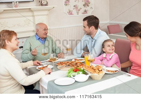 Cute three generations are gathering together in restaurant
