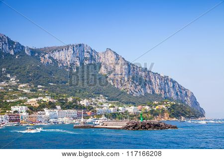 Entrance Of Capri Port, Italy. Boats Go Near Breakwater