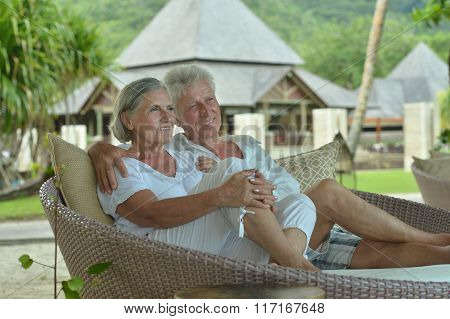 Amusing old couple at cafe table