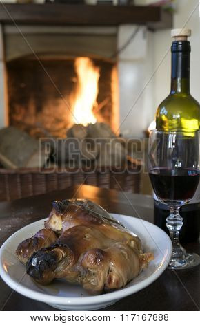 Red Wine Goblet And Roast Piglet Round The Fireside