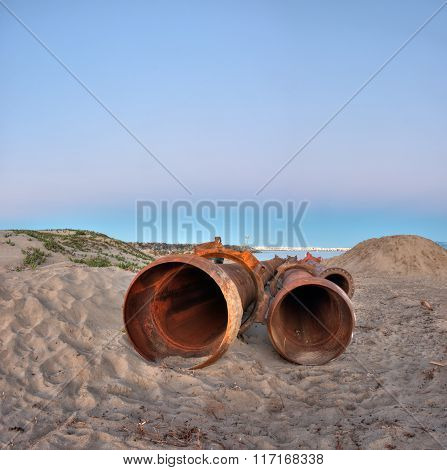 Dredge pipes lying on the beach for assembly