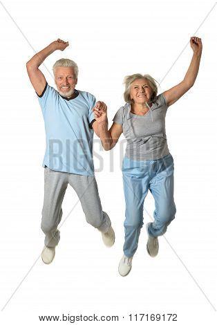 Senior couple jumping
