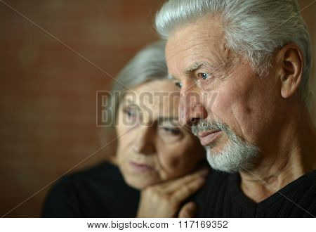 Mature couple near wall