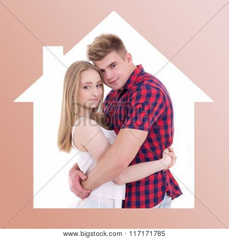 Love And Home Concept - Young Man And Woman In House Frame