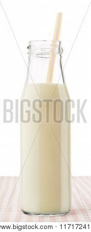 Bottle Of Milk With Straw On Checkered Tablecloth