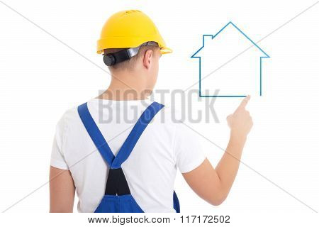Construction Concept - Man In Builder Uniform Drawing House Isolated On White