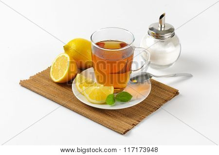 cup of black tea with lemon and sugar