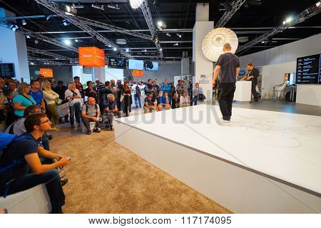 COLOGNE, GERMANY - SEPTEMBER 19, 2014: Sony stand in Photokina Exhibition interior. The Photokina is the world's largest trade fair for the photographic and imaging industries