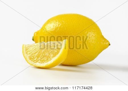 close up of fresh juicy lemon on white background
