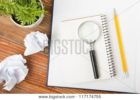 Office desk table with supplies and crumled paper. Top view. Copy space for text