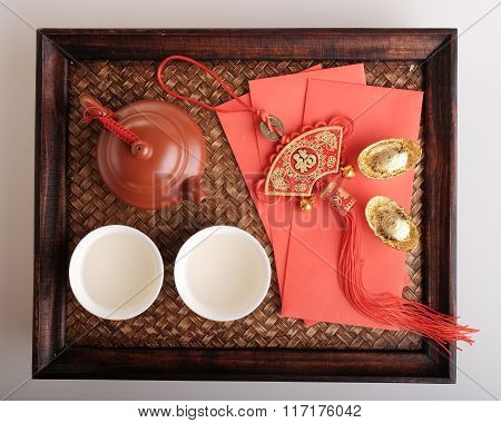 Hot Chiese tea and red packets