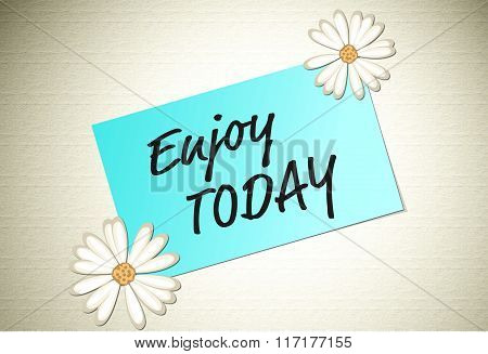 Enjoy today positive message on paper note with flowers on the corners