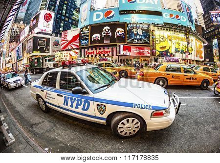 Times Square In New York In Afternoon Light With Police Car