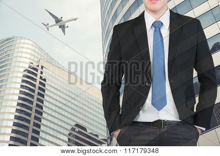 Double Exposure Of Businessman And Airplane Flying Above Glass Office Buildings
