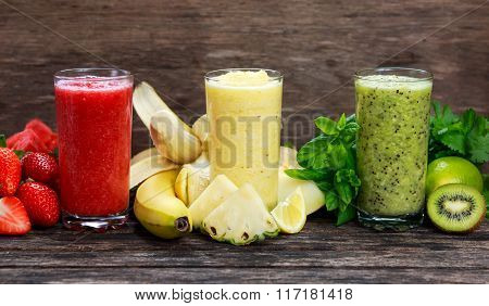 Fresh smoothies in the glass - Red, yellow and green