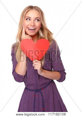 Portrait of cute joyful woman holding red heart shaped postcard and showing cheek for kiss isolated on white background, happy Valentine day