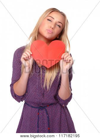 Portrait of cute joyful woman with red paper heart in hands isolated on white background, kiss with love, happy Valentine day
