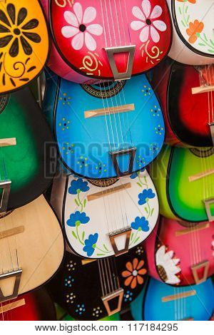 Colorful traditional mexican guitars on market. Great for background