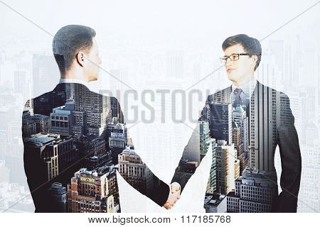 Double Explosure With Businessmen Shake Hands And Financial City Disctrict