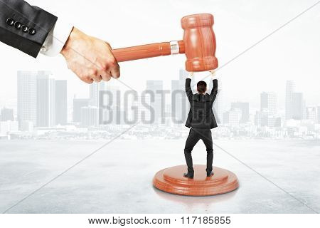 Sentence Concept With Businessman Resists Gavel At City Background