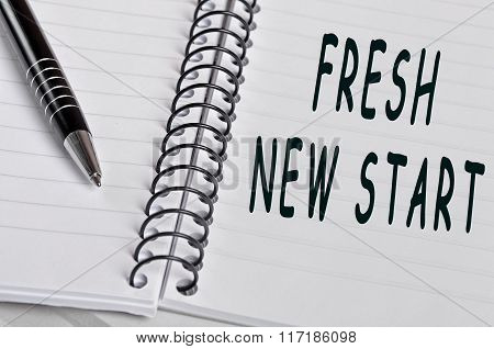 Fresh new start words on notebook page