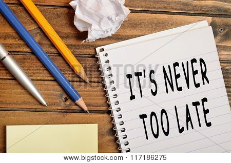 It's never too late words on notebook