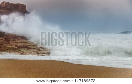 Storm Waves Roll Over The Beach And Clap On Rocks