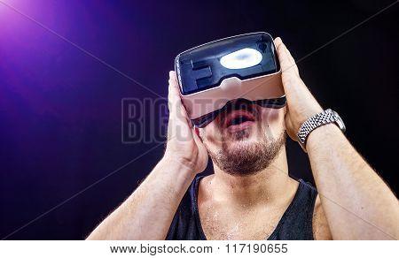Man has fun using his Virtual Reality VR glasses