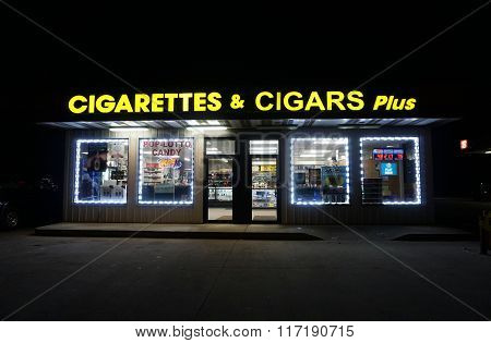 Cigarettes & Cigars Plus During the Night