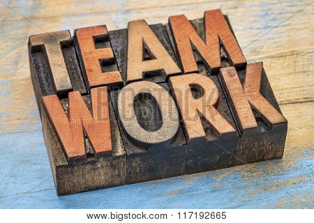 teamwork word abstract in vintage letterpress wood type printing blocks stained by color inks
