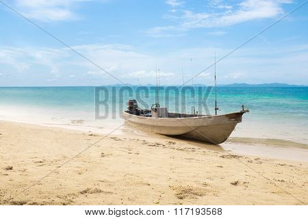 Small old fishing boat on beach at Koh Chang Island