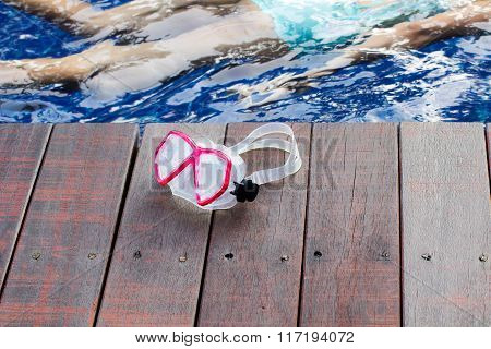 goggles on the wood poolside