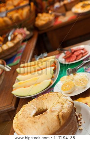 Bakery Table With Fruits And Cake