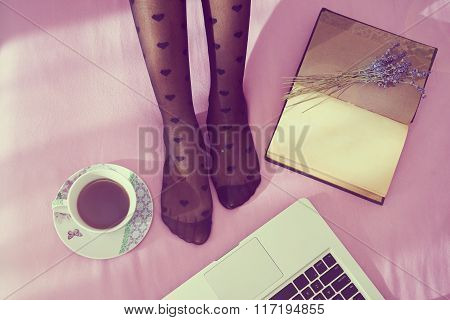 Woman On The Bed With Laptop, Notebook And Cup Of Coffee