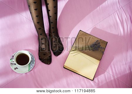 Woman On The Bed With Notebook And Cup Of Coffee