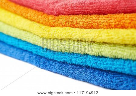 Rainbow colored pile of towels isolated