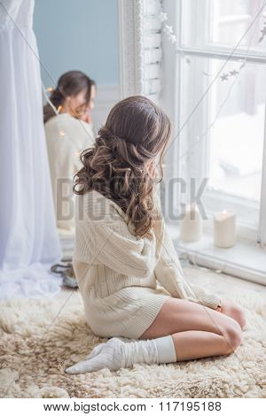 beautiful woman relaxing near window