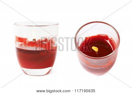 Half-burned lit red candle isolated